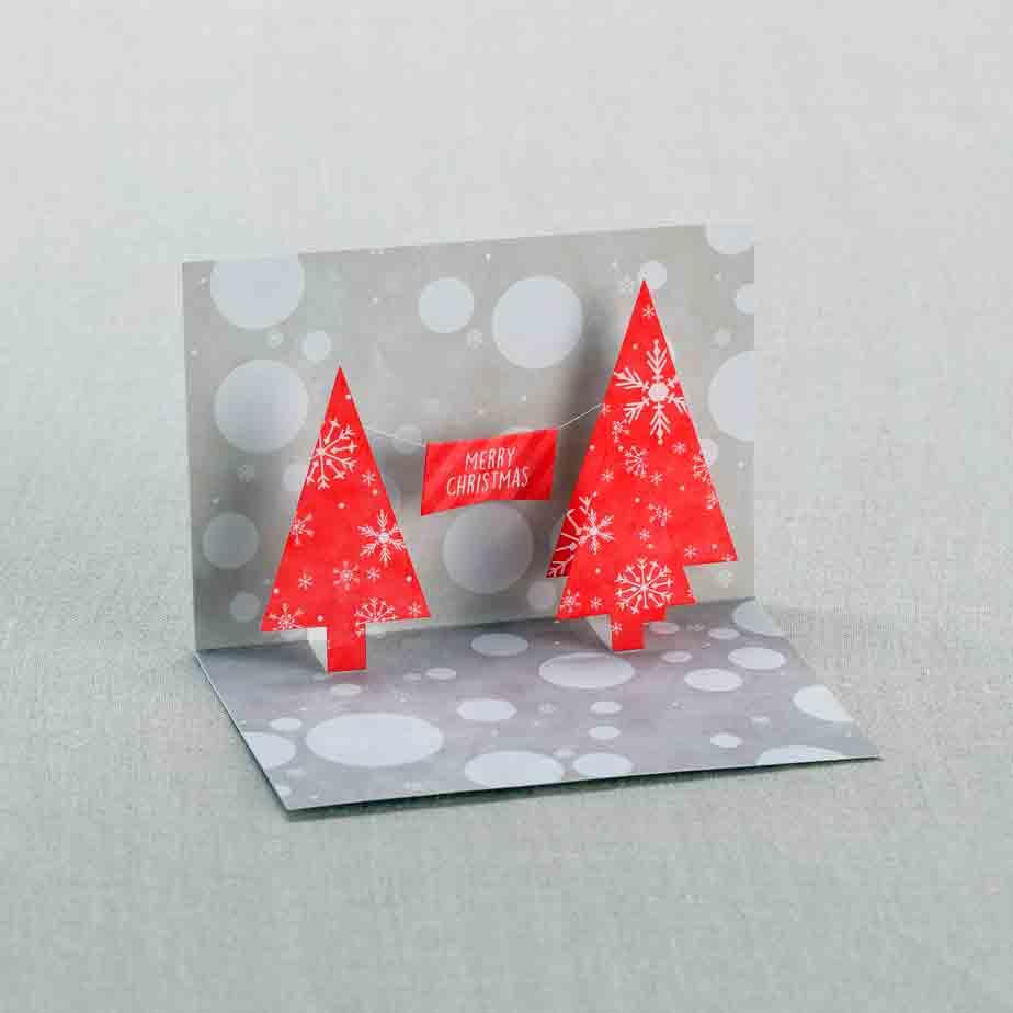 Обемная новогодняя открытка с ёлками